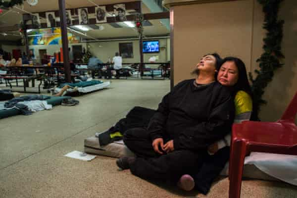 Steve Moses and Marie Nickolai sit on a mattress in Bean's Cafe.