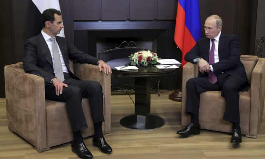 Russian President Putin meets with Syrian President al-Assad in Sochi on November 20, 2017.
