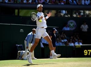 Djokovic breaks serve.