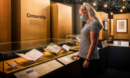 Woman looks at exhibition in British Library