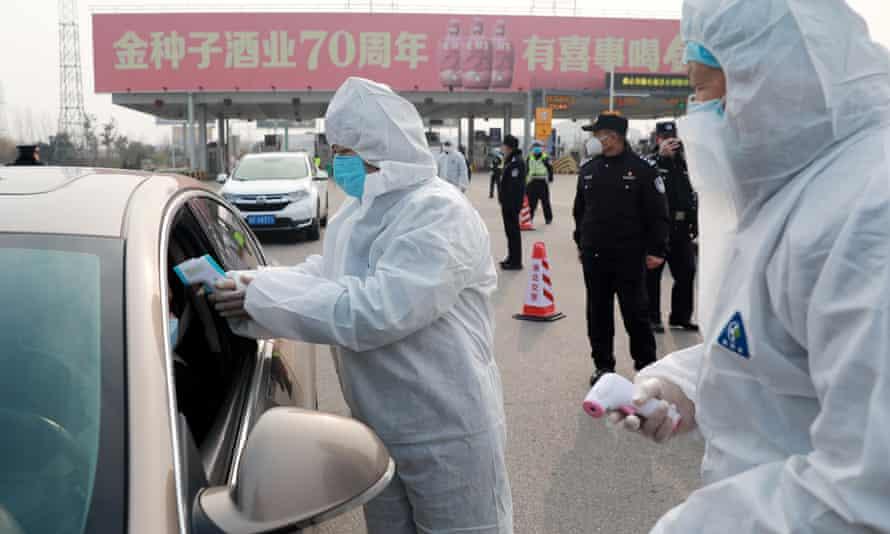 Workers screen travellers for coronavirus.