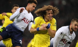 David Luiz winces during Chelsea's defeat against Tottenham at Wembley.
