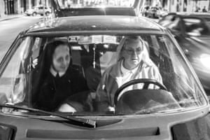 Sister Erminia and Sister Pina in the community car on their commute to feed the homeless.