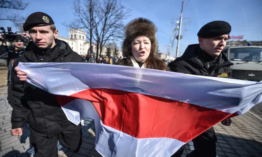 Police detain an opposition supporter in Minsk.
