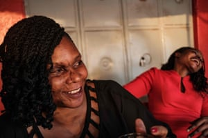Close friends Reenah Ntoreinwe (left) and Linette Kirungi (right) are pictured at their local bar in Kampala. They met each other as acid survivors; they go out together, visit other survivors and support each other when things get difficult.