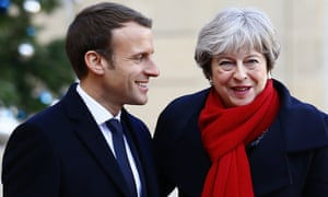 Theresa May is welcomed by President Emmanuel Macron before a lunch at the Élysée Palace in Paris on Tuesday.