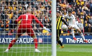 Jimenez shoots towards the goal.