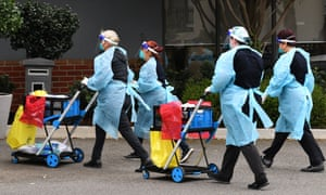 Healthcare workers arrive at the Arcare Aged Care centre in Maidstone