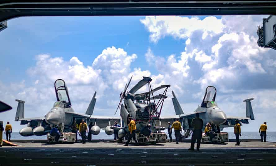 US navy sailors aboard the aircraft carrier USS Theodore Roosevelt in the South China Sea.
