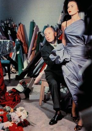 Christian Dior draping fabric over fashion model Sylvie c. 1948