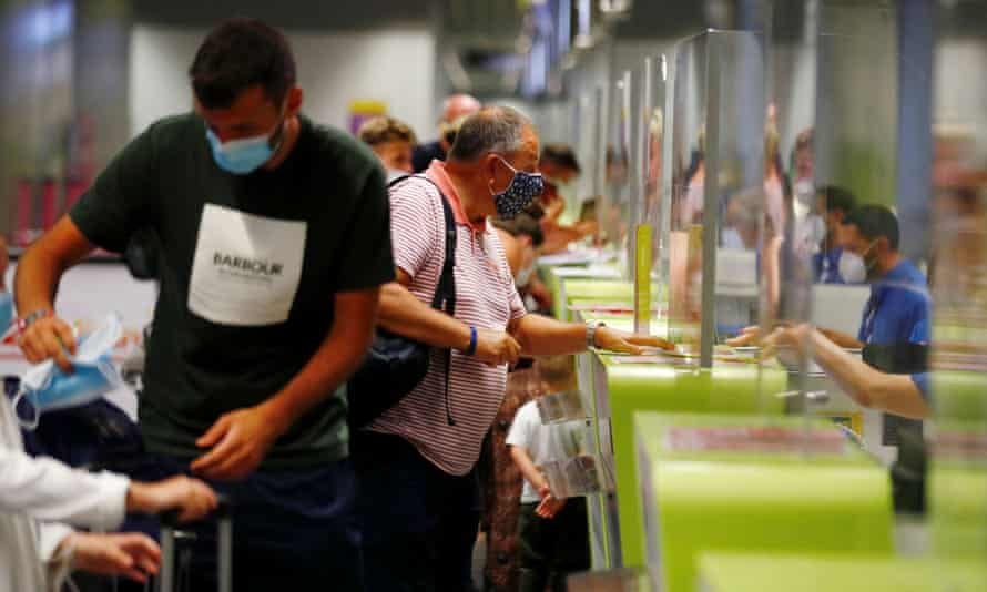 British tourists returning to the UK check in their luggage after the new quarantine rule was announced.