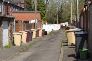 A back street between two rows of terraced houses in Bolton.