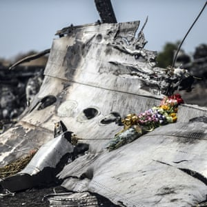 Flowers left by parents of an Australian victim on a piece of the wreckage