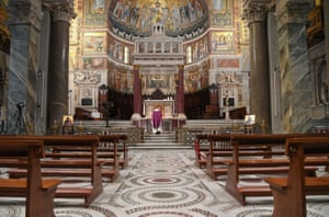 Priest Don Marco conducts Sunday mass alone in the Basilica of Santa Maria in Trastevere, Italy