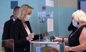 French far-right National Rally leader Marine Le Pen casts her ballot at a polling station for France Regional elections on June 20, 2021 in Henin-Beaumont, France.