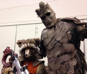 Guardians of the Galazy cosplayers dressed as Rocket and Groot.