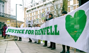 Demonstrators outside the Grenfell Tower public inquiry in Paddington, west London.