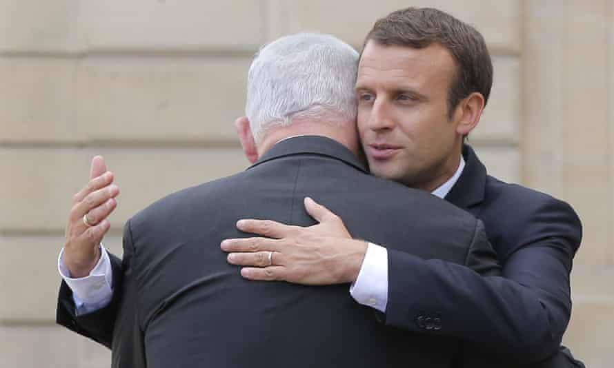 Emmanuel Macron hugs the Israeli prime minister, Benjamin Netanyahu