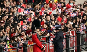 Smiling crowd waving flags