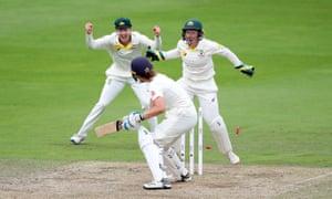 Australia's Alyssa Healy and Meg Lanning celebrate as England's Natalie Sciver is bowled by Jess Jonassen.