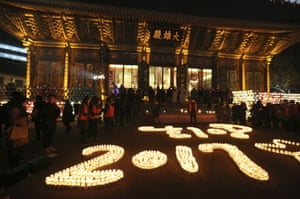Buddhists light candles at Jogye Temple in Seoul, South Korea