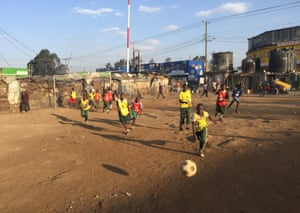 Children play football on a former dump in Mathare, a shanty town where plastic rubbish was once as high as a man, say locals.