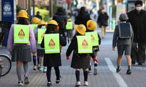 Children walk to school in Tokyo, Japan, 28 February 2020. Japanese Prime Minister Shinzo Abe requested on 27 February 2020, that all school close starting 02 March 2020, until the end of spring vacation.