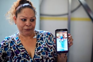 In a migrants shelter in Tijuana, Laura Lara Romero shows a video of her daughter, who is still in the US.