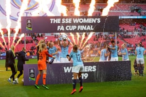 Manchester City players celebrate with the trophy after winning the Women's FA Cup final against West Ham at Wembley.