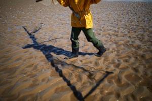 Owen walks on the sand