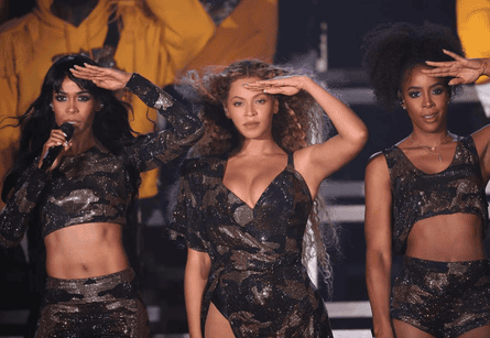 Beyoncé reunited in camo with Destiny's Child collaborators Kelly Rowland (left) and Michelle Williams (right).