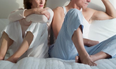 Couple in bed not speaking