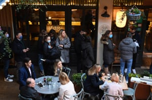 Customers dining in Soho in London, today. ahead of the move into Tier 3 restrictions tomorrow which will see pubs and restaurants close once again.