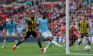Manchester City's Raheem Sterling scores his team's sixth goal.