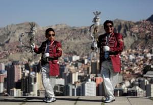 La Paz, Bolivia. Santos Poma and his grandson Ariel pose for a photo before a parade in honour of Señor del Gran Poder