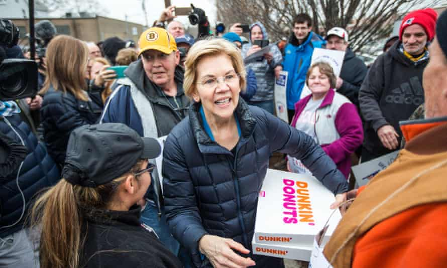 The Democratic presidential candidate Senator Elizabeth Warren greets striking Stop & Shop workers while also bringing coffee and donuts on Friday in Somerville, Massachusetts.