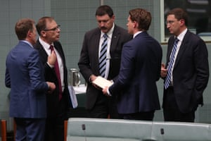 Andrew Hastie, Anthony Byrne, Mike Kelly and Julian Leeser talk to Christian Porter during voting procedures.