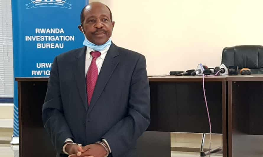 Paul Rusesabagina is paraded in front of media in handcuffs at the headquarters of the Rwanda Investigation Bureau in Kigali.