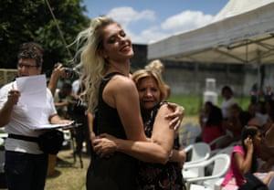 Woman hugs older woman