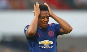 Anthony Martial reacts after his shot flashes wide of goal in the first half.