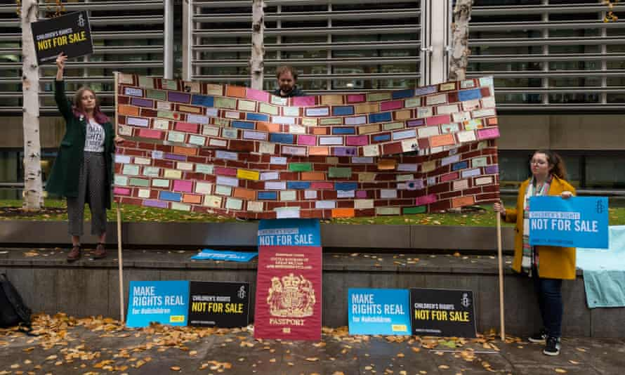 Amnesty International activists gather outside the Home Office on 25 November.