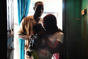 Souleymane and Minata (not their real names, with their young son.