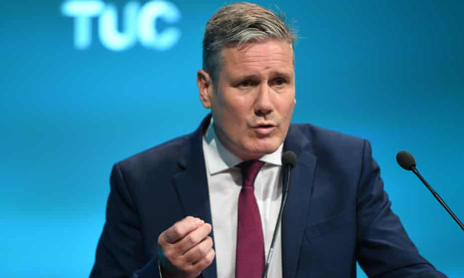 Keir Starmer giving a speech agains a blue background at the Trades Union Congress 2021 in London in September.
