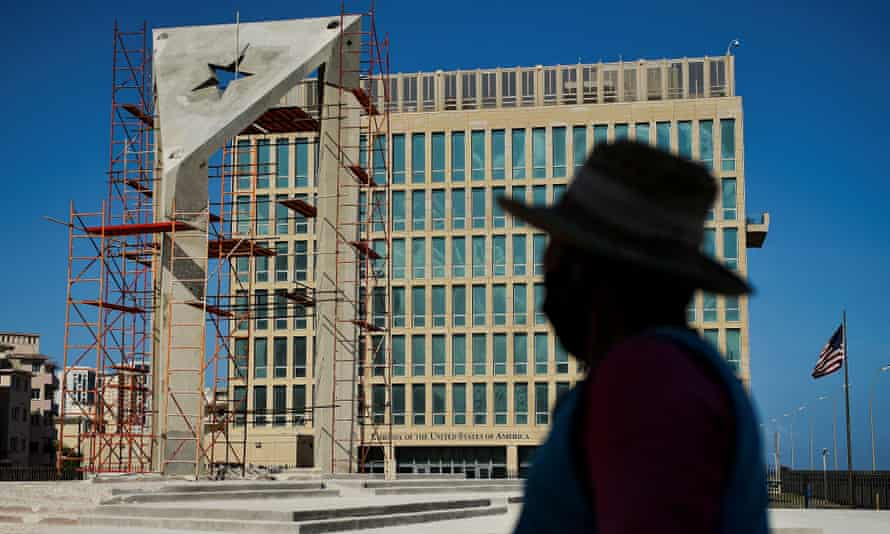 A worker looks at a huge concrete Cuban flag being build in front of the US embassy in Havana, on 1 April.
