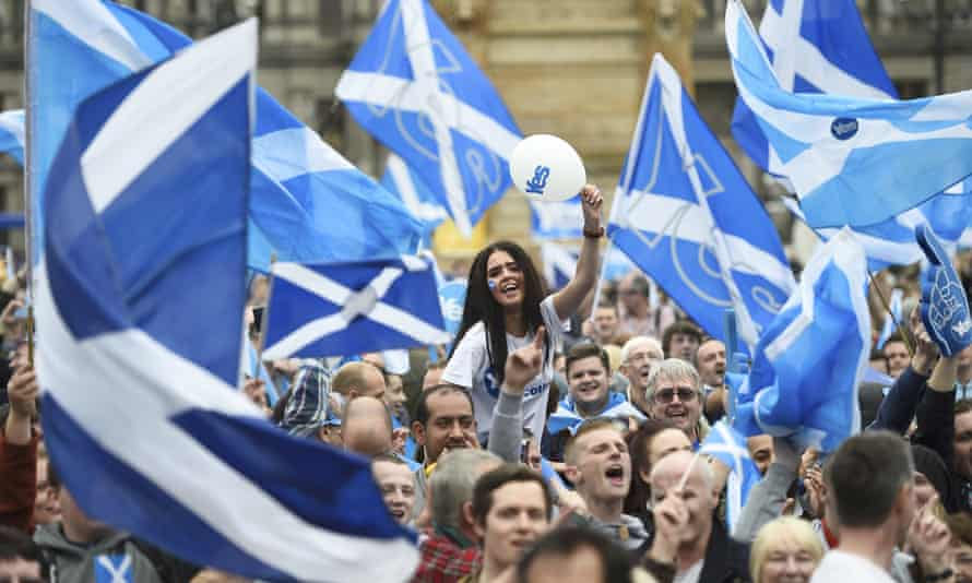 Campaigners wave Scottish flags at a yes campaign rally in Glasgow, Scotland, in September 2014