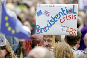 A man holds a banner calling for an end to the 'Brexistential crisis'