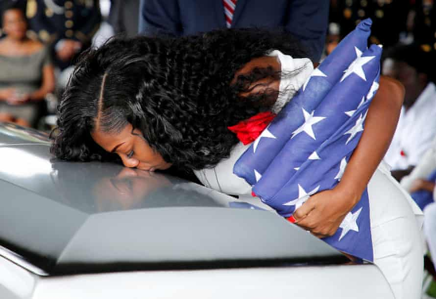 Myeshia Johnson, widow of one of US soldiers killed, kisses coffin