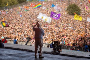 'He's relatable because he's passionate' … the audience at Glastonbury watching David Attenborough.