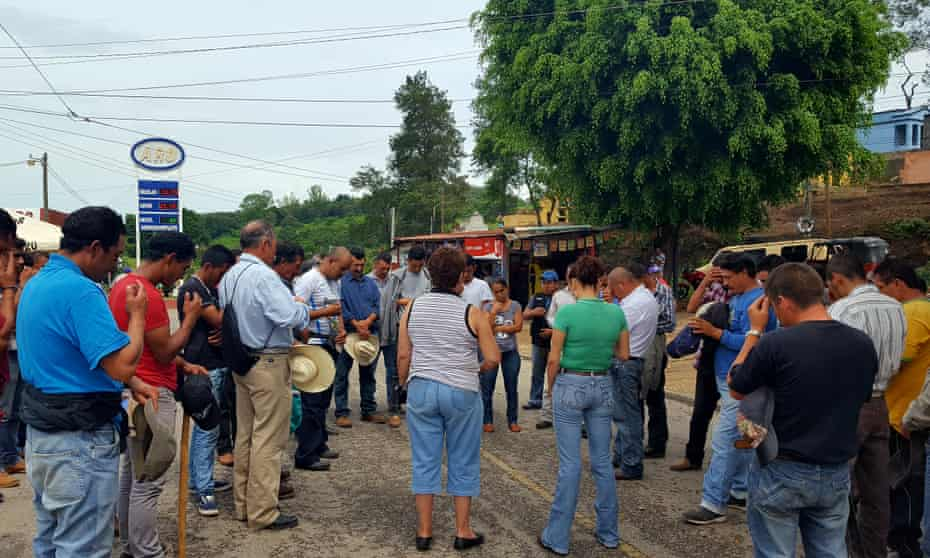 Protesters in the community of Casillas, praying for calm amid rumours the army is on its way to evict their anti-mining roadblock