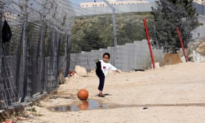 A Palestinian boy plays outside his house in the Shuafat refugee camp.